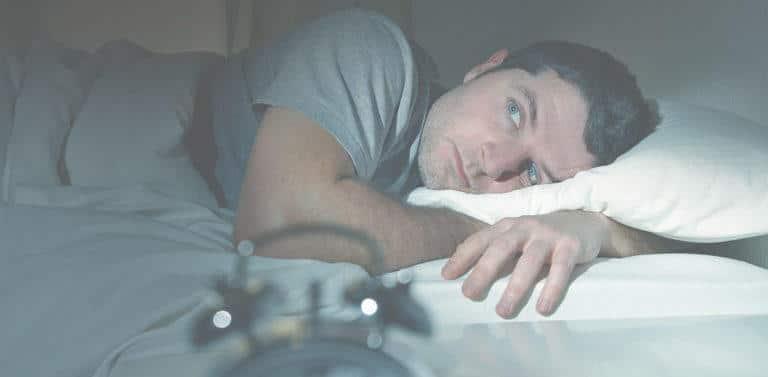 Man lying awake late at night